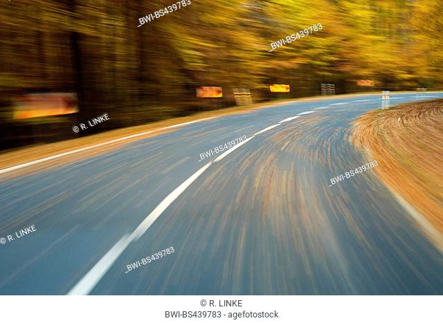 Road View from a Car Drive in Autumn Forest, Germany, Bavaria, Spessart