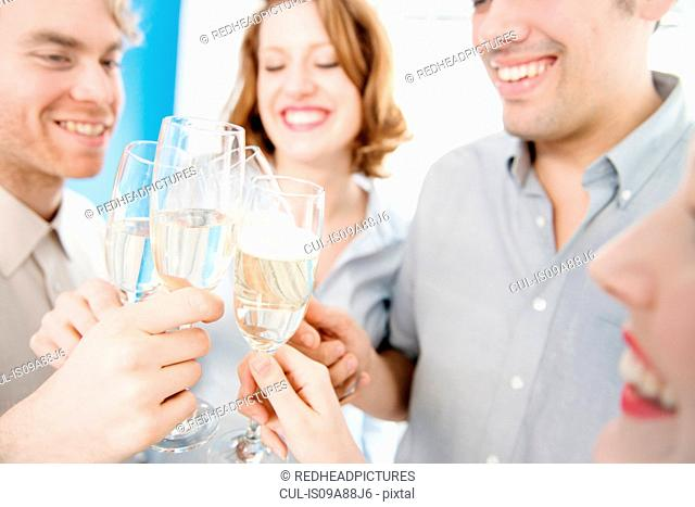 Colleagues toasting with champagne glasses