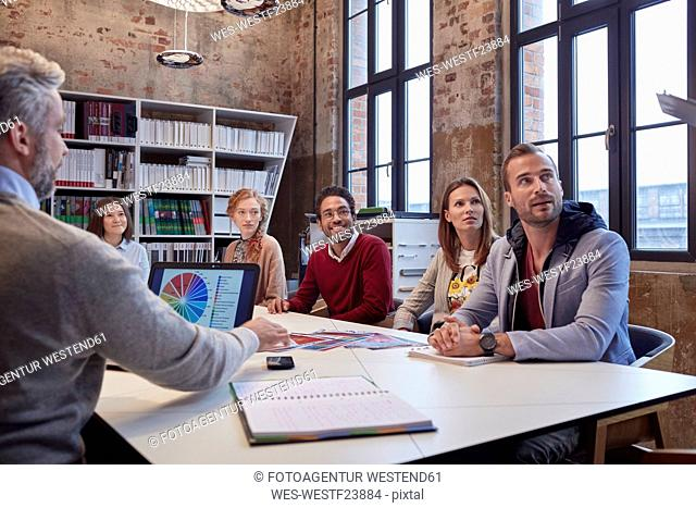 Business people at a strategy meeting in the office