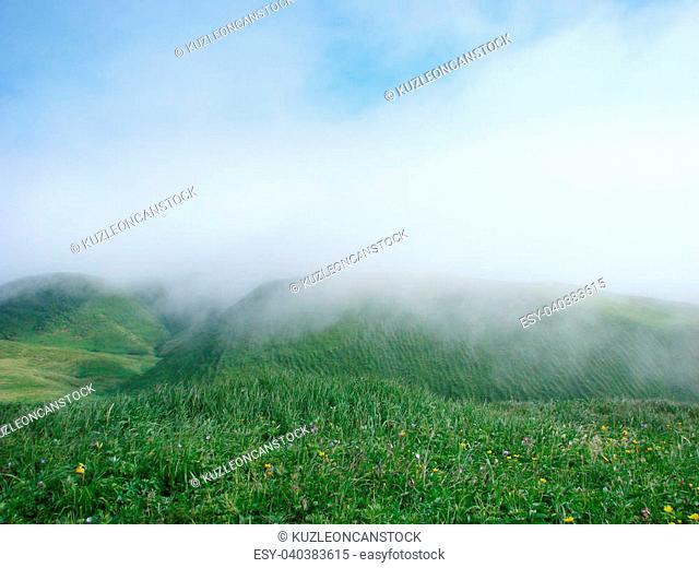Russia, island Urup. Steep coast from passage Fruze