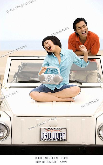 Asian couple listening to portable radio