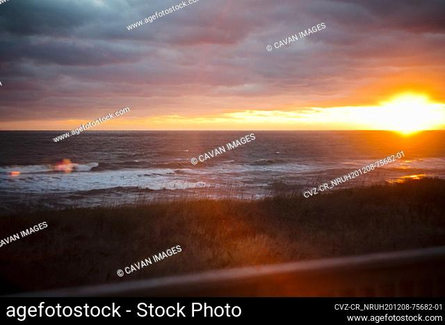 Sunrise over the ocean with cloud cover