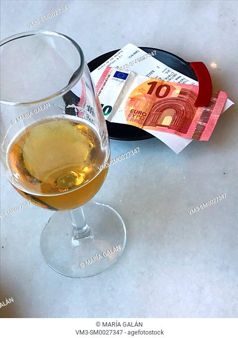 Glass of beer, bill and payment