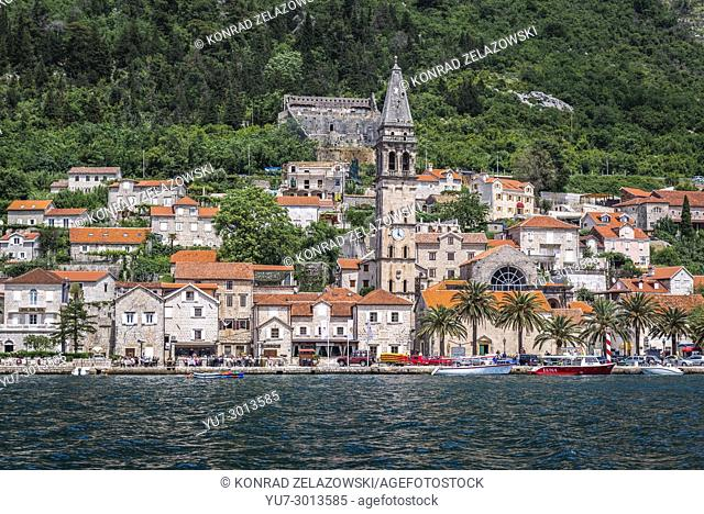 Perast historical town seen from the Bay of Kotor on the Adriatic Sea in Montenegro. View with St Nicholas church nad Saint Cross fortress