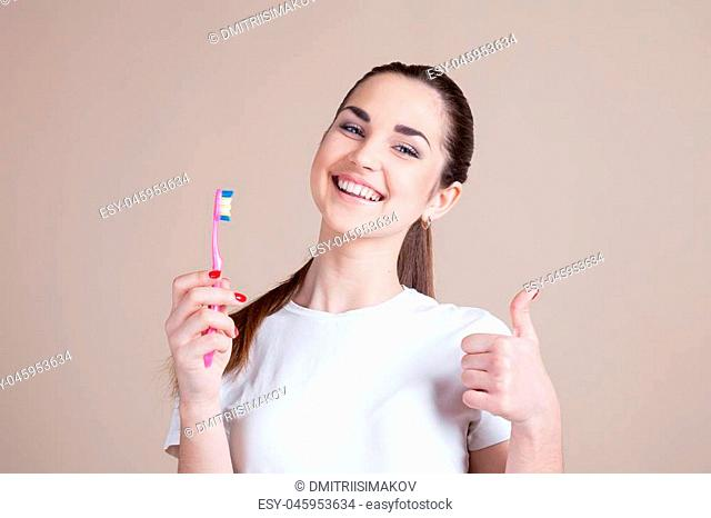 girl with a toothbrush in foto studio