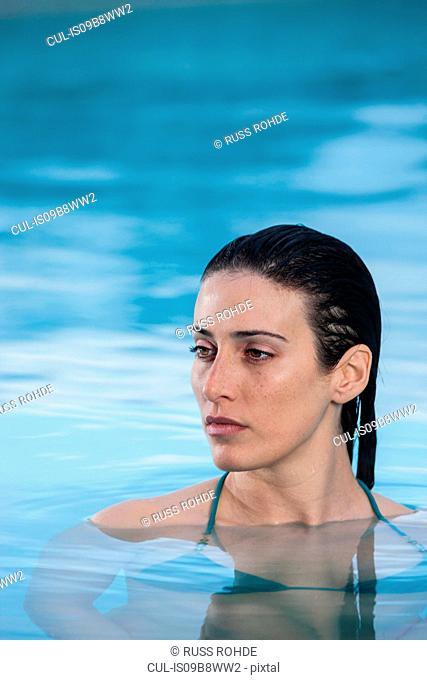 Woman relaxing in thermal pool