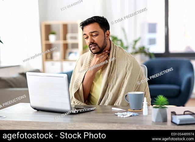 sick indian man having video call on laptop