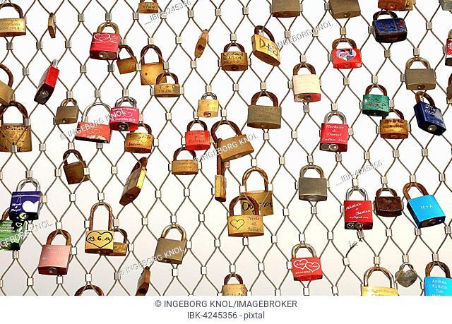 Love locks hanging on metal grid, Heiligenhafen pier, Schleswig-Holstein, Germany