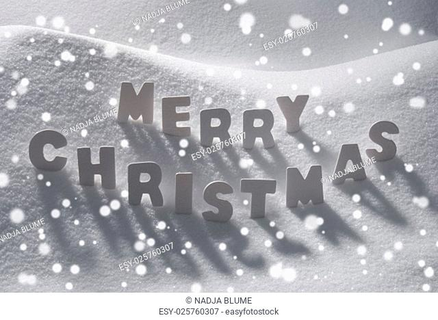 White Wooden Letters Building English Text Merry Christmas. Snow And Snowy Scenery With Snowfalkes. Christmas Atmosphere