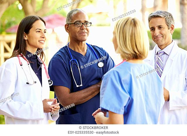 Medical Team Having Discussion Outdoors