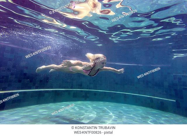 Woman underwater in a swimming pool