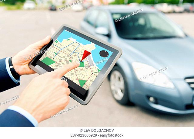 transport, business trip, navigation, technology and people concept - close up of male hands with gps navigator on tablet pc computer and car outdoors