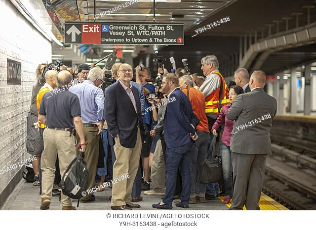 MTA Chairman Joe Lhota, center, outside a gaggle of press. Seventeen years after being destroyed on September 11, 2001 the Cortlandt Street-Word Trade Center...