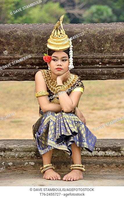 Apsara dancer taking a break at Angkor Wat in Siem Reap, Cambodia