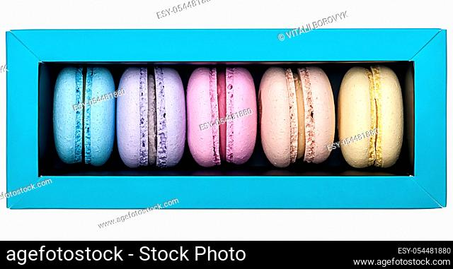 Multicolored macaroon in box top view on white background