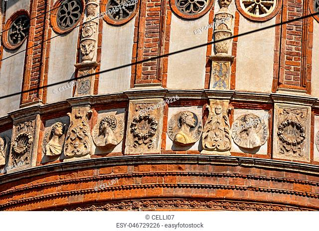 Detail of decoration and sculptures outside the church of Santa Maria delle Grazie, in the city center of Milan, a large and modern city