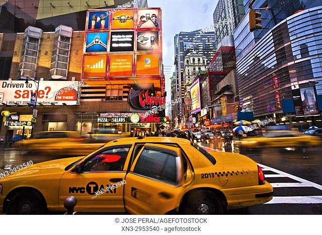 Person taking a taxi in rainy day, 8th Avenue and W 42nd St, Times Square, Midtown, Manhattan, New York, New York City, United States, USA