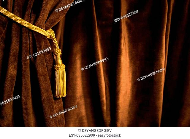 Brown theatre curtain and yellow tassels