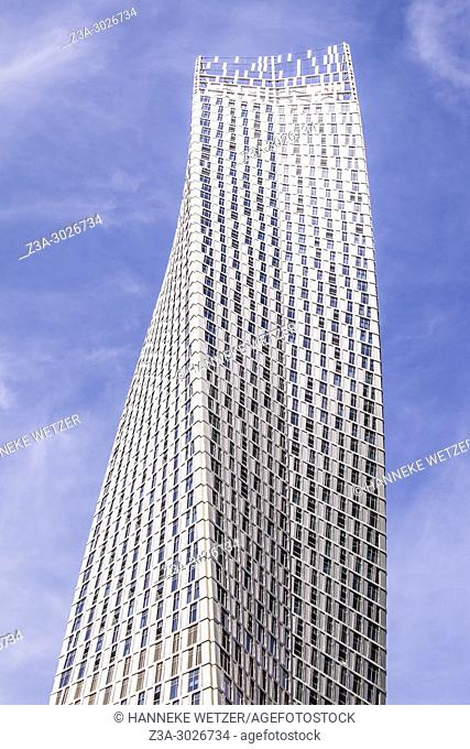 The Cayan Tower at Dubai Marina, Dubai, UAE. The Cayan Tower is a luxury apartment building with a striking helical shape