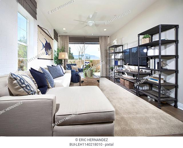 Contemporary living room with furniture and shelves at home; Palm Desert; California; USA