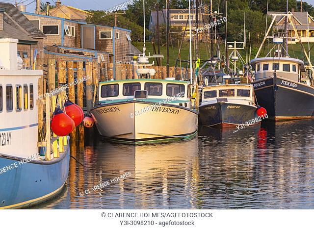 Commercial fishing boats docked in Menemsha Basin, in the fishing village of Menemsha in Chilmark, Massachusetts on Martha's Vineyard