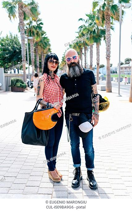 Portrait of mature hipster couple on sidewalk, Valencia, Spain