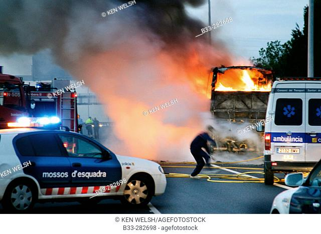Burning bus on highway. Barcelona province, Spain