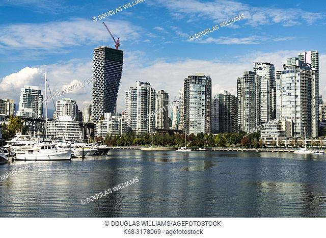 downtown apartment buildings, skyline with Canada House on left, and False Creek in foreground, Vancouver, BC, Canada
