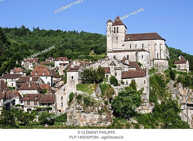 View over houses and the fortified church of the medieval village Saint-Cirq-Lapopie, Quercy, Midi-Pyrénées, France