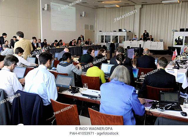 The participants of the two-day special meeting of the Commission for the Conservation of Antarctic Marine Living Resources (CCAMLR) arrive in the conference...