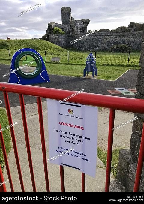 Empty playground with bilingual Welsh/English sign due to UK Government imposed lockdown restrictions due to Coronavirus, Covid-19, Aberystwyth, Ceredigion