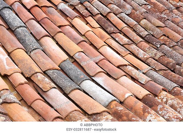 Old clay tile roof detail in horizontal format. Warm tone