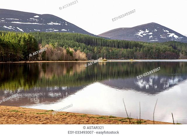 Water reflection at Loch Morlich in Scotland