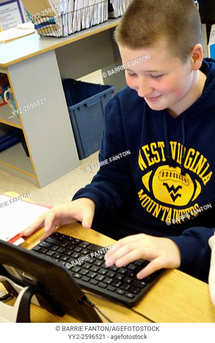 6th Grade Boy Working on iPad, Wellsville, New York, United States