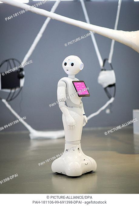 "06 November 2018, Hamburg: Robot """"Pepper"""" communicates with journalists and guests in the exhibition """"Out of Office"""": When robots and AI work for us"""" at a..."