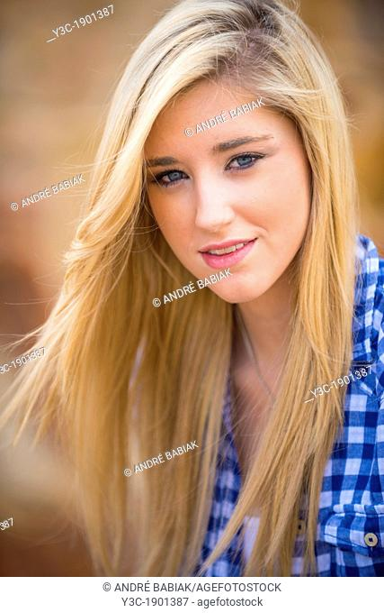 Portrait of female Caucasian teenager with long blond hair