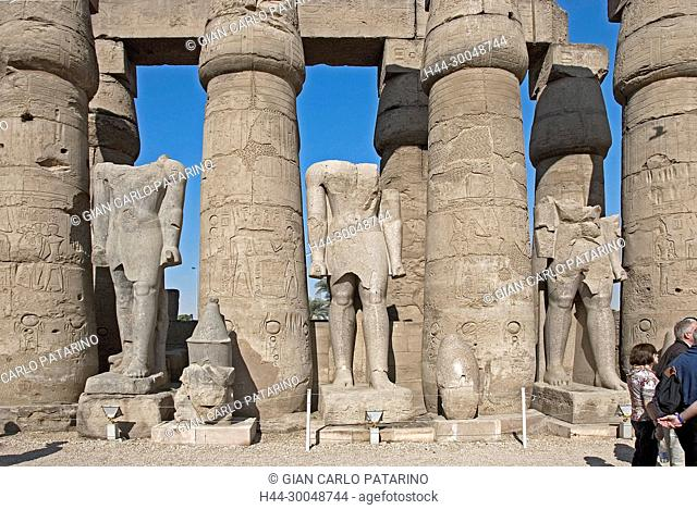 Luxor, Egypt. Temple of Luxor (Ipet resyt): remains of three giant statues in the courtyard