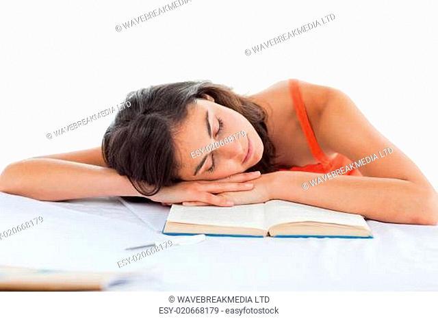 Sleeping student head on her books