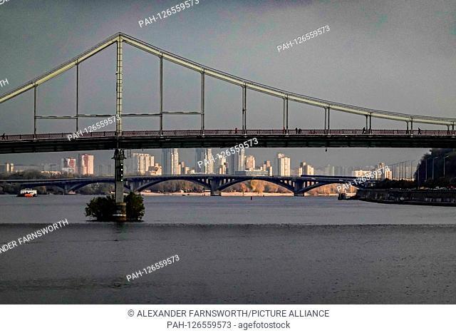 Kiev, Ukraine The Pishokhidnyy Mist Cherez Dnipro bridge on the Dnieper river.   usage worldwide. - KIEV/Ukraine