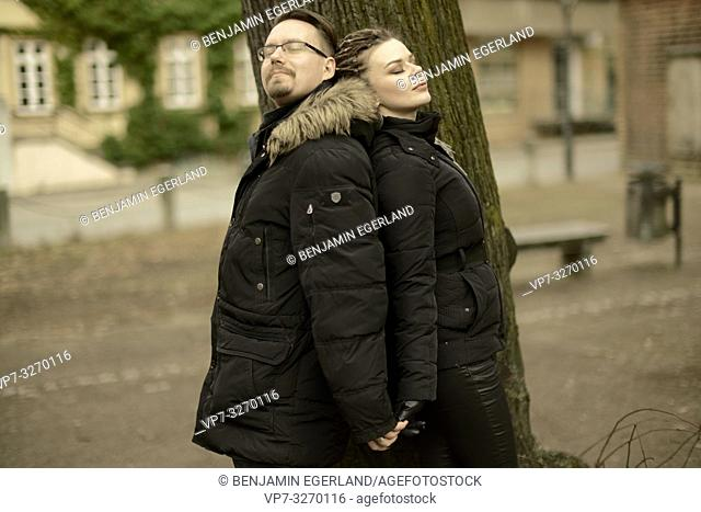 couple next to tree in park in city, in Cottbus, Brandenburg, Germany