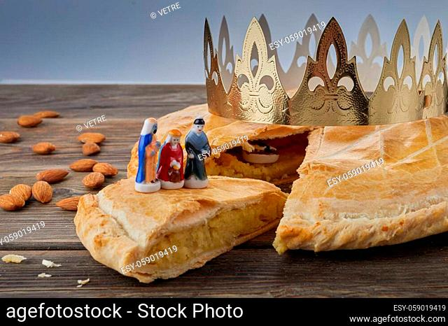 Epiphany cake, French Galette de rois with figure of three kings