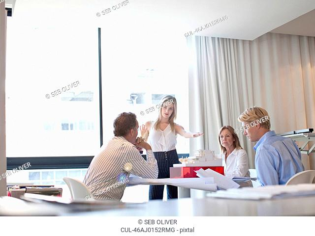 Business people with model in office