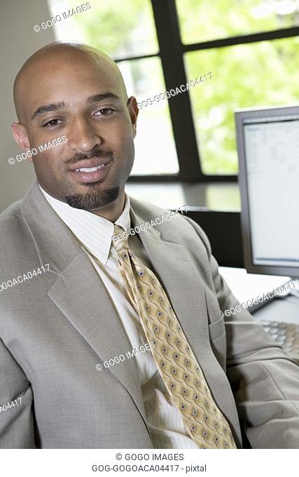 Businessman smiling at his desk