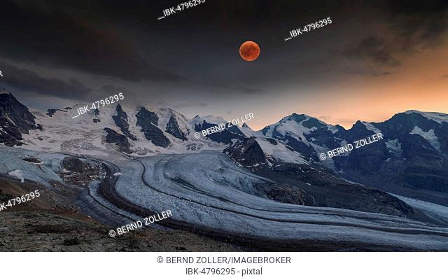 Panoramic view of the Bernina Group with blood moon, Piz Palü, Bellavista, Crast Agüzza, Piz Bernina, Piz Morteratsch, Pers Glacier, Morteratsch Glacier