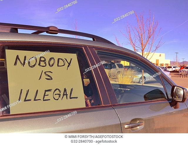 sign in car window, New Mexico (pertaining to immigration policies). A protest