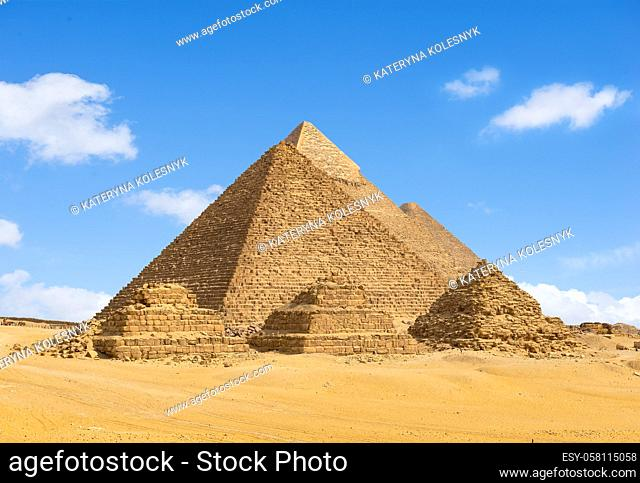 Egyptian pyramids in desert of Giza in a row