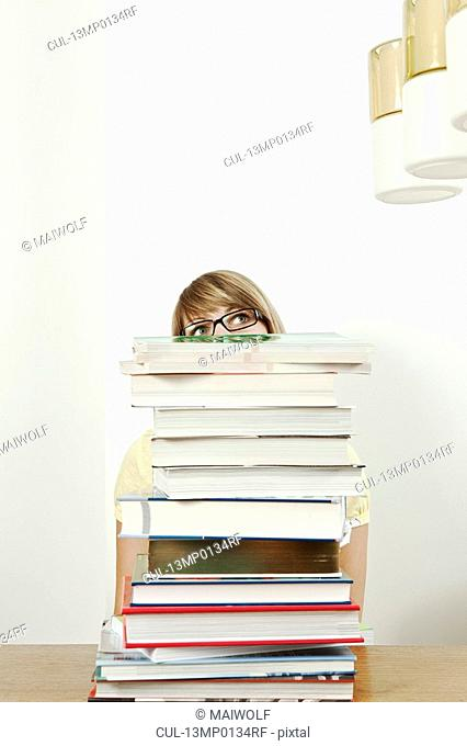 Female student with stack of books