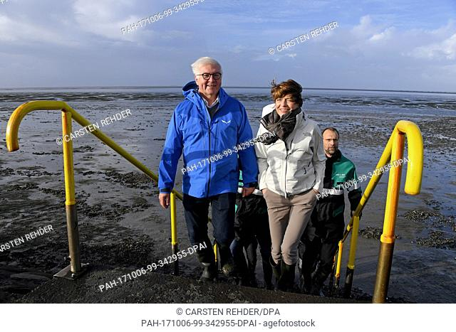 German federal president Frank-Walter Steinmeier and his wife Elke Buedenbender can be seen standing in the mud flats near Hamburger Hallig, Germany