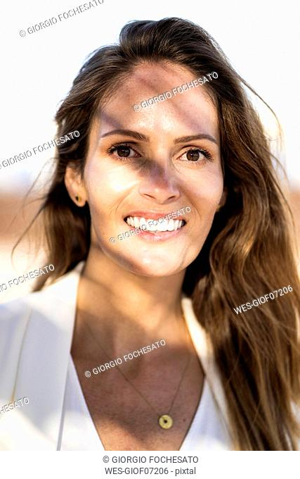 Portrait of smiling businesswoman outdoors