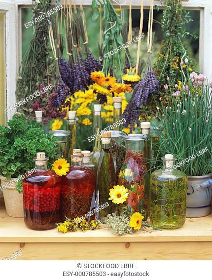 Herb oil, herb vinegar, blackcurrant liqueur & culinary herbs